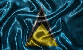 Wallpaper by Saint Lucia flag and waving flag by fabric. stock photo