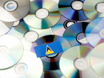 Saint Lucia flag on top of CD and DVD pile isolated on white Royalty Free Stock Image