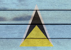 Saint Lucia flag on a wood Royalty Free Stock Image