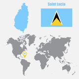 Saint Lucia map on a world map with flag and map pointer. Vector illustration Stock Photos