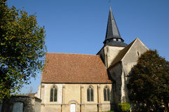 The Saint Lucien church of Avernes Stock Photo
