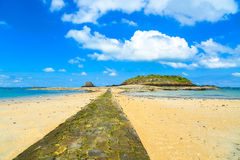 Saint Malo bay, stone pathway, Grand and Petit Be Fort during Low Tide. Brittany, France. Royalty Free Stock Photos