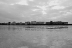 Saint Malo beach in black and white. With view to the buildings on the shore stock images