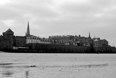 Saint Malo beach in black and white. With view to the buildings on the shore stock photo