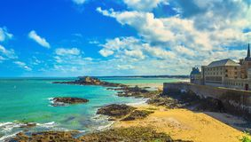 Saint Malo beach, city walls and Fort National. Low tide. Brittany, France. Saint Malo sand beach, city walls and Fort National. Low tide. Brittany, France stock photo