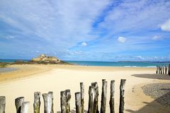 Saint-Malo, the beach in low tide and the national fort (Brittany France) Royalty Free Stock Images