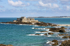 Saint Malo beach and sea. View of a fort on an island closed to the French walled city of Saint Malo from the sea royalty free stock photography