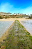 Saint Malo beach and stone pathway, low tide. Brittany, France. Royalty Free Stock Photos