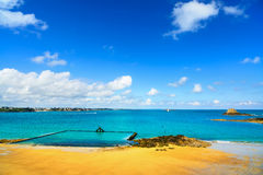 Saint Malo beach view from wall ramparts and fort. Brittany, Fra. Saint Malo beach view from wall ramparts and fort on background. View to Dinard. Brittany Stock Image