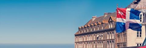 Saint Malo flag and houses, panoramic background, Brittany France. Saint Malo flag and houses, panoramic background, Brittany, France stock photography