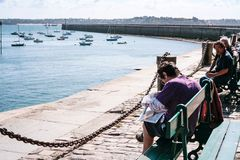 citizens rest on quay in port Saint-Malo town Royalty Free Stock Images