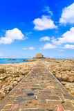 Saint Malo, Petit Be Fort and stone pathway during Low Tide. Brittany, France. Stock Image