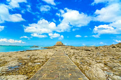 Saint Malo, Petit Be Fort and stone pathway during Low Tide. Brittany, France. Royalty Free Stock Images