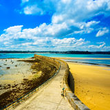 Saint Malo pier or jetty and lighthouse. Brittany, France. Saint Malo pier or jetty and lighthouse during Low Tide. Brittany, France, Europe Stock Photo