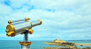 Saint-Malo, telescope pointing national's fort (Brittany France). Royalty Free Stock Photo