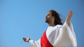 Saint man looking at sky with opened hands, Jesus resurrection and ascension. Stock footage stock footage