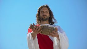 Saint man offering bottle of water, biblical history to give drink to thirsty. Stock footage stock video footage