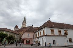 Saint Margaret Sf. Margareta church in the afternoon seen from the main square of Medias, one of the main cities of Transylvania. NnPicture of St. Margaret Royalty Free Stock Photography
