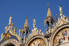 Saint Mark Basilica spires. Beautiful spires, freizes, and statues of San Marco in Venice Stock Images