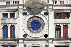 Saint Mark clock tower and building in Venice, Italy. Saint Mark clock tower and building in Venice with gold zodiac signs in a sunny day in Italy stock photography