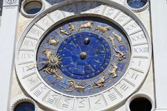 Saint Mark clock tower in Venice with gold zodiac signs in Italy. Saint Mark clock tower in Venice with gold zodiac signs in a sunny day in Italy stock photography