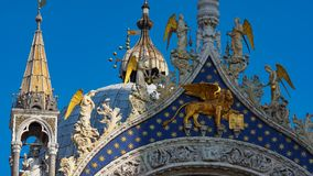 Saint Mark`s Basilica in Venice, ITALY. Architectural details of Saint Mark`s Basilica, Venice, Italy. Saint Mark`s golden lion. Symbol of the Serenissima Stock Photos