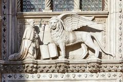 Free Saint Mark Winged Lion, White Stone Statue In Sunlight In Venice Stock Photos - 125617853