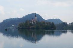 Saint Martin church, Bled lake, Slovenia. Saint Martin church in the fog on the island of Bled lake, Slovenia Stock Photos