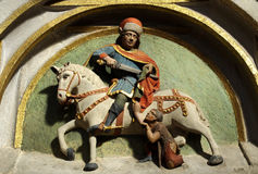 Saint Martin cuts his cloak for a beggar. Sculpture of Saint Martin cutting his cloak for a beggar Royalty Free Stock Image