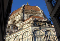 Saint Mary of the Flower dome seen from Florence narrow street Stock Images
