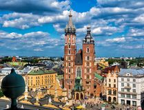 Saint Mary`s basilica in main square of Krakow on a sunny day. C