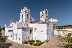 Saint Mary`s Church of the Castle, Tavira, Portugal. The Church of Saint Mary of the Castle - Igreja de Santa Maria do Castelo in the picturesque town of Tavira Stock Photo