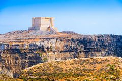 The Saint Mary`s Tower 1618 on Comino island, Malta. Saint Mary`s Tower 1618 aka Comino Tower is a large bastioned watchtower in Comino, Malta Royalty Free Stock Photography