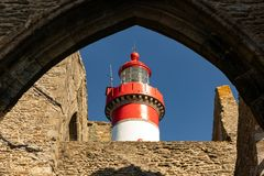 Lighthouse behind the ruins of the abbey royalty free stock image