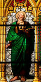Saint Matthew the Evangelist. Church window in the Dom of Cologne, Germany, depicting Saint Matthew the Evangelist. The window, made in the Royal Glass Painting Royalty Free Stock Photo