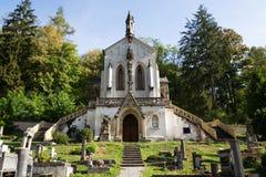 Saint Maximilian Chapel on cemetery in Saint John under the Cliff, Svaty Jan pod Skalou, Czech Republic stock images