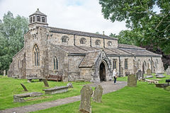 Saint Michael and All Angels Church, Linton. 11th and 12th Century Church, Saint Michael and All Angels , Linton, Yorkshire Dales with gravestones around it royalty free stock photography