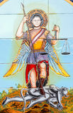 Saint Michael the Archangel. Painting on tiles showing Saint Michael the Archangel defeating Satan stock photography