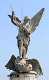 Saint Michael archangel full body sculpture. A full body sculpture of saint Michael archangel holding a spear in his hands and step up in a dragon as the devil stock photography