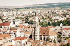Saint Michael Catholic Gothic Church in Unirii Square and old historic medieval center of Cluj-Napoca Stock Photo