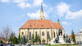 Saint Michael Church and Matei Corvin Statue in Unirii Square in Cluj-Napoca. Cluj-Napoca, Romania - 10 April: Timelapse in Uniri Square in the historic center stock video footage