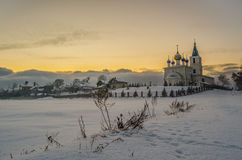 Saint Michael church in the snowy fields Royalty Free Stock Photos