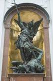 Saint Michael defeats Satan Stock Photos