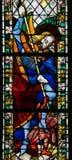 Saint Michael trampling Satan Stock Image