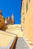 Saint-Michel Archange Basilica under blue sky in Menton, France . Stock Image