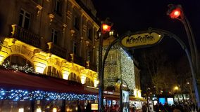 Saint-Michel - Notre-Dame Metropolitain. This is the Saint-Michel - Notre-Dame RER Metro station street entrance surrounded by Christmas lights. This sattion royalty free stock photos