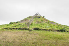 Saint-Michel tumulus. Megalithic grave mound named Saint-Michel tumulus near Carnac, a commune in the Morbihan department of Brittany, France Royalty Free Stock Photo