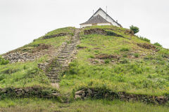 Saint-Michel tumulus. Megalithic grave mound named Saint-Michel tumulus near Carnac, a commune in the Morbihan department of Brittany, France Royalty Free Stock Photography