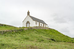 Saint-Michel tumulus. Megalithic grave mound named Saint-Michel tumulus near Carnac, a commune in the Morbihan department of Brittany, France Royalty Free Stock Image