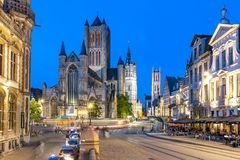 Saint Nicholas Church, Belfort Tower And St. Bavo Cathedral At Night, Gent, Belgium Stock Photography